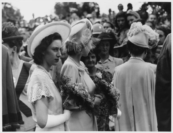 ROYAL TOUR OF SOUTH AFRICA & RHODESIA: The lovely sisters Princess Margaret (aged 17) and Princess Elizabeth (aged 21) circulating at a garden party, have many admirers
