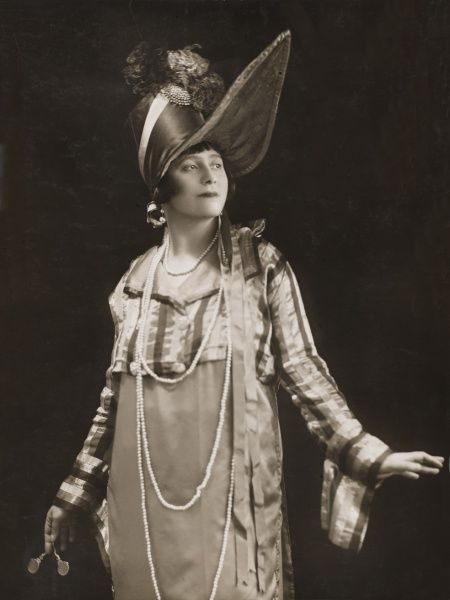 "Madame Maria Levinskaya, Russian pianist, pictured wearing an exaggerated costume of the Napoleonic era, as part of her series of recitals given wearing historical dress under the title, ""Musical Cameos&quot"