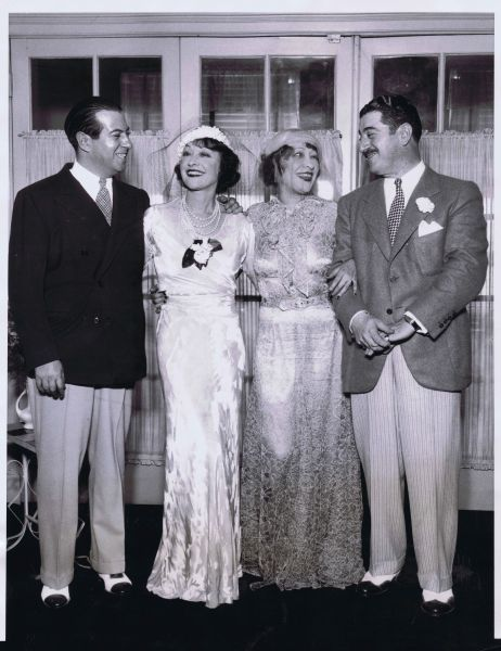 Jenny Dolly and Bernard Vinissky (right) during their wedding ceremony July 1935, Chiaago. On left is Rosie Dolly (Mrs Irving Netcher) and Ircving Netcher. Date: 1935