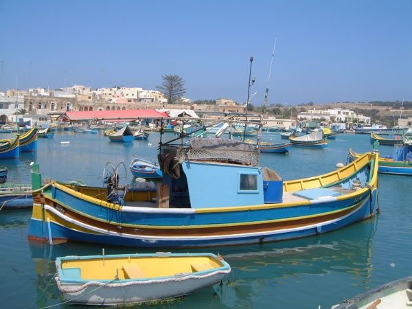 Harbour view with luzzus (painted fishing boats)