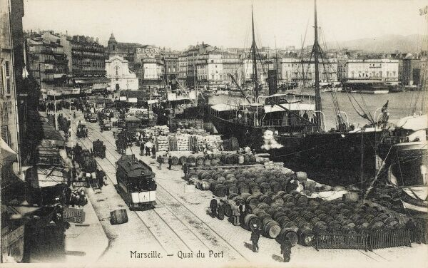 Marseilles, France. The Quayside with wine barrels lined up ready for export