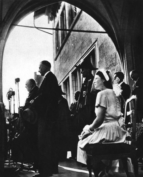 Speaking to a large audience from a balcony of Berne town hall, Switzerland:Mr. Winston Churchill with the state president of Berne and(right) Miss Mary Churchill, his youngest daughter