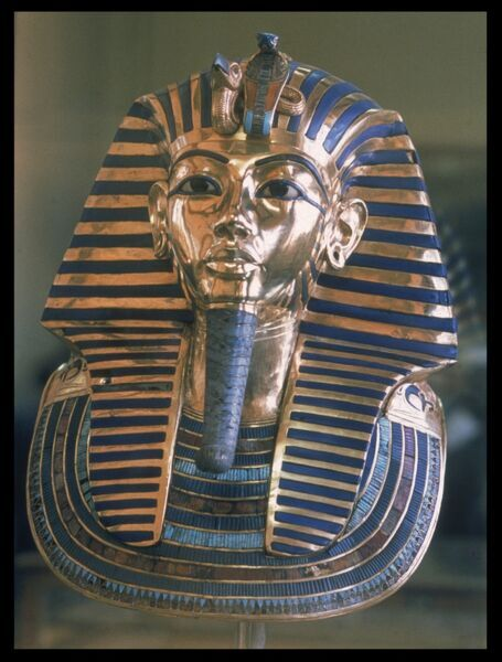 The famous mask of Pharoah TUTANKHAMUN, ruler of the 18th Dynasty of Egypt 1361 - 1352 BC, (Egyptian Museum, Cairo), made of solid gold, with inlaid glass and lapis lazuli