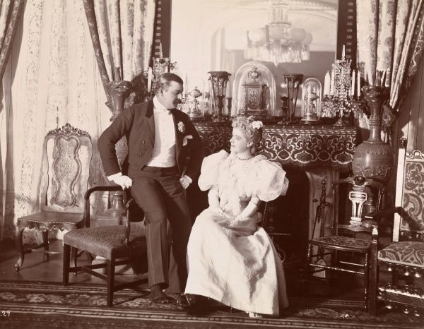 Ball, Twelfth Night Masquerade, Stevens Residence. A man and woman posed in room at the Twelfth Night Masquerade at the Stevens Residence at Castle Point in Hoboken, New Jersey