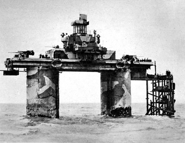 Photograph showing a Sea Fort, designed by G.A. Maunsell, situated in the Thames Estuary during the Second World War, 1944. This fort was in commission as a warship, being manned by Royal Marines under the command of RNVR officers