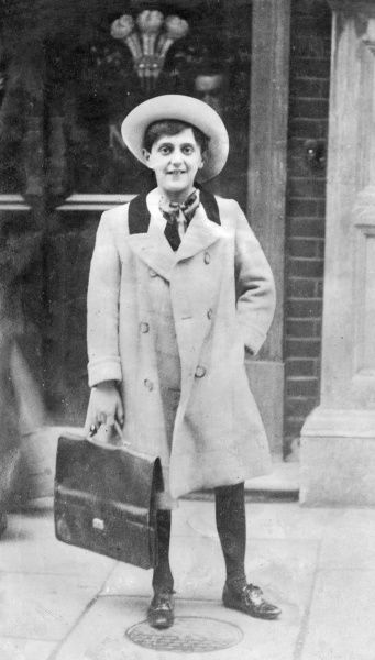 Maximillian Arnold (Max) Darewski (1894-1929), a musical prodigy who composed, conducted and played the piano. Seen here as a teenager, in coat and hat, carrying a music case