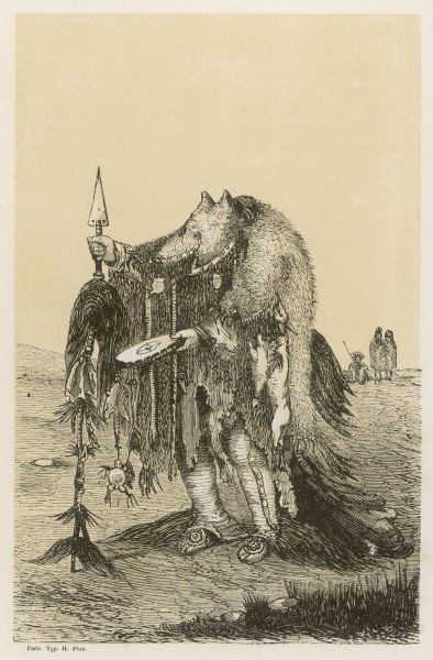 Medicine man of the Crow or Blackfeet people : he is wearing the skin of a young bear