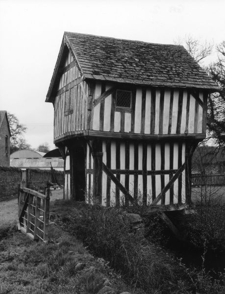 The crooked medieval gatehouse of Lower Brockhampton Hall, Bringsty, Herefordshire, England. Date: 14th century