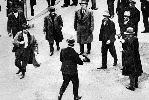 A plain clothes policeman, in centre, using his revolver to keep strikers apart from a free labourer during the Melbourne Waterside Workers strike of 1928. Fighting broke out when the Unionists strongly objected to the New Transport Workers Act