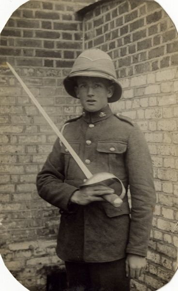 Reuben Davey, soldier of the 17th/21st Lancers, a British cavalry regiment formed in 1922. Seen here in uniform, including pith helmet, with sword in hand