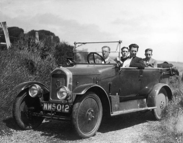 Four young men enjoy a drive in the country