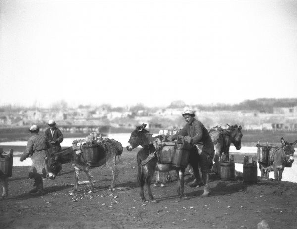 A group of local men with donkeys on a trip through Kashgar, western China. Photograph by Ralph Ponsonby Watts
