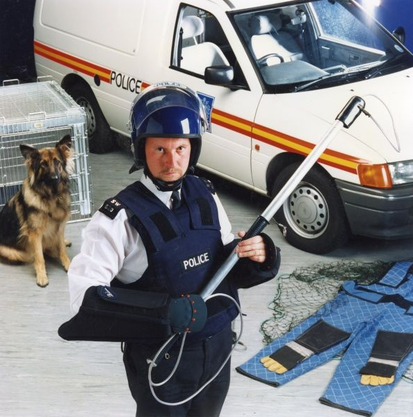 Officer of the Metropolitan Police Dog Handling Unit, wearing protective clothing worn to prevent injury when capturing dangerous animals