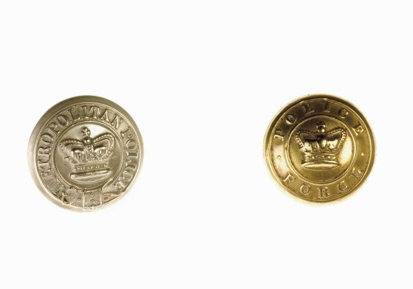 Two Metropolitan Police buttons, one with a silvery finish, the other gold