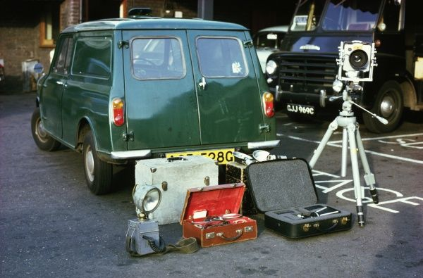 Metropolitan Police investigation equipment, set out on the ground at the back of a green van