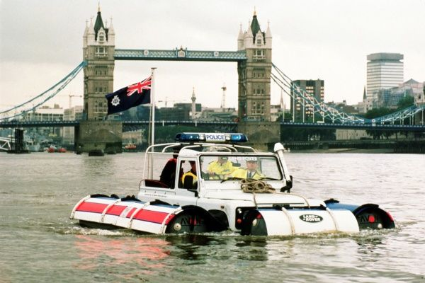 A Metropolitan Police launch on the River Thames, with Tower Bridge in the background