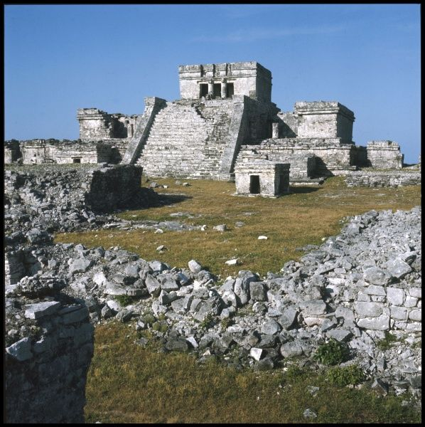 Quintana Roo, Tulum. View of the Mayan temple called El Castillo on the Caribbean coastline. This large pyramid has two columns depicting serpents