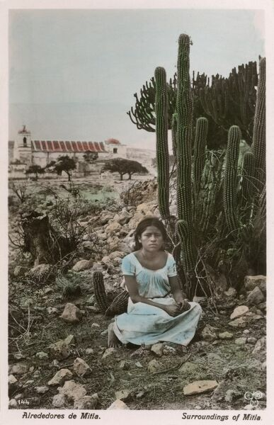 Mexican girl posing next to a cactus plants in the outskirts of Mitla, Mexico