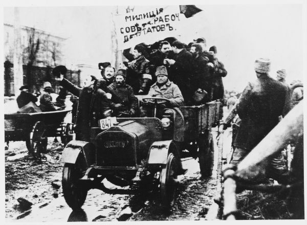 Ukrainians back the revolution - soviet workers' military drive enthusiastically through the streets of Kiev