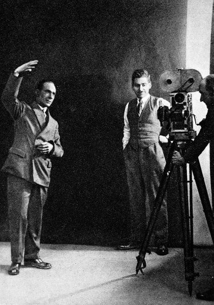 Human speech the result of a variety of movements made by the muscles which control the lungs. A typical deaf-mute gesture, the sign language for sunshine, as posed for in front of a cinematograph camera