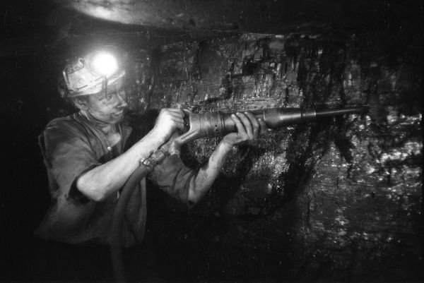 Miner using an hydraulic drill at the coal-face, at Cape Bank Hall Pit, Burnley, in Lancashire