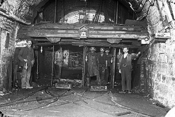 A group of miners at the pit bottom of Tirpentwys Colliery, near Pontypool in South Wales