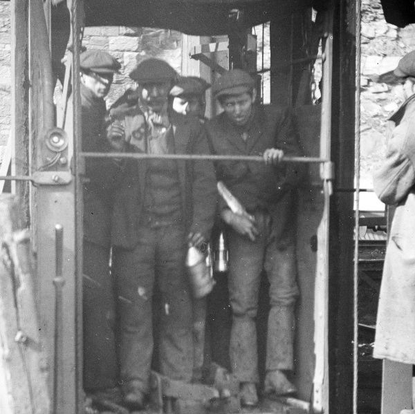 Miners standing in a shaft lift at Llanerch Colliery near Pontypool in South Wales
