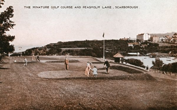 View of the Miniature Golf Course and Peasholm Lake (right), at Scarborough, North Yorkshire. Date: 1920s