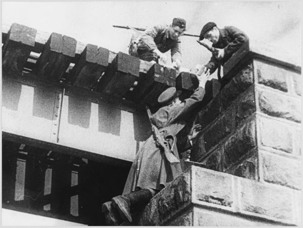 A Partisan group in Byelorussia plant mines on a railway bridge