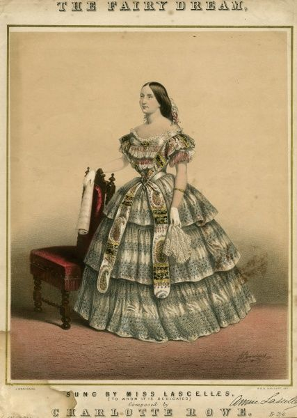 Miss Annie Lascelles, singer, wears a gown with a skirt comprised of 3 flounces that appear to be decorated with beads. The bodice is trimmed with rows of lace & fringing Date: 1850s