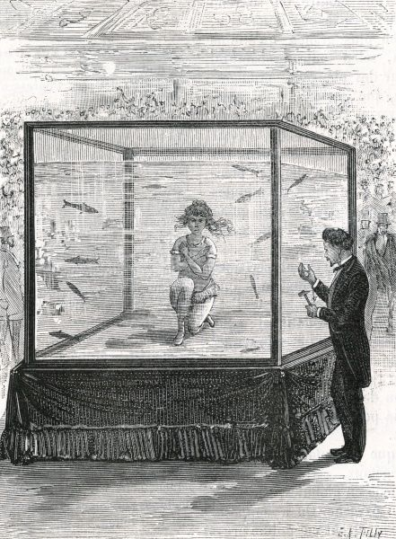 MISS LURLINE performs in a tank at the Cirque des Champs- Elysees, Paris ; she performs acrobatics and even eats, remaining underwater for two and a half minutes at a time Date: 1882