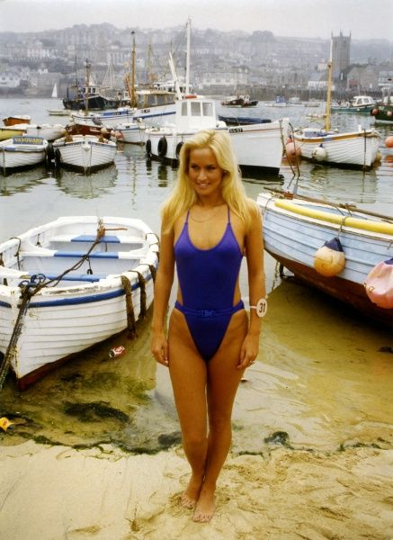 One of the contestants in the Miss UK regional finals poses in St Ives harbour, Cornwall in a revealing one-piece swimsuit