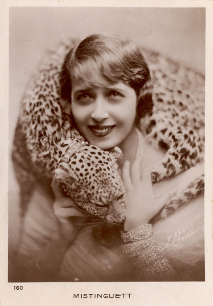 MISTINGUETT (Jeanne Bourgeois) French actress and dancer with a leopard wrapped around her neck - just for decoration, you understand