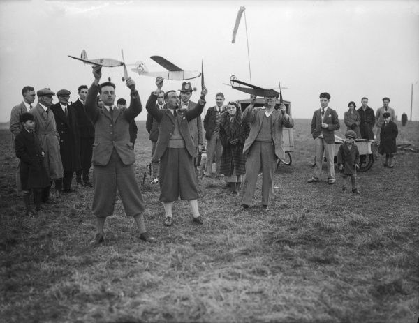 Men (some wearing plus fours) and boys, members of Brighton District Model Aircraft Club, England