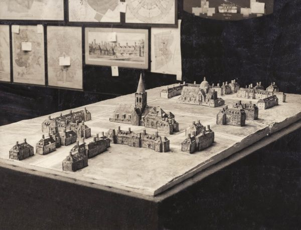 A small scale model of Central Square, Hampstead Garden Suburb. Central Square was laid out by Sir Edwin Lutyens, and includes St Jude's Church, The Free Church and a Quaker Meeting House. Hampstead Garden Suburb was founded in 1907 by Henrietta Barnett