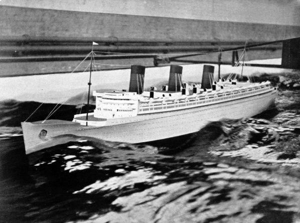 Photograph of an 18-foot model of the R.M.S. 'Queen Mary' being tested in an experimental tank. The designers were seeing how the ship would cope with an 'Atlantic Gale' when run at full speed (approximately 30 knots)