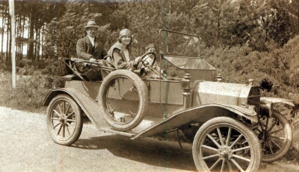 A family taking a drive in the country in a Model T Ford Roadster