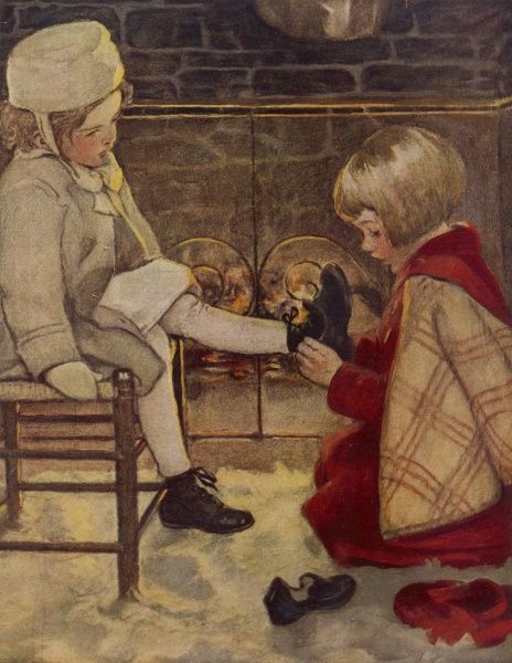 A little girl helps a younger child with her shoes or boots, recalling the tale of Cinderella