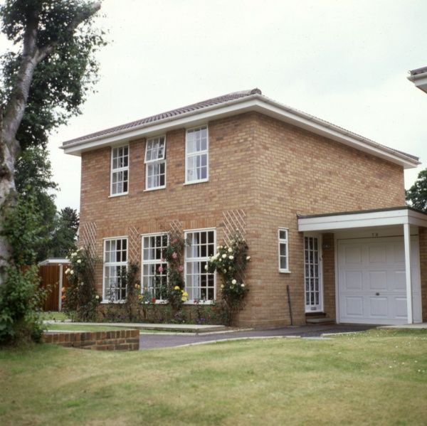A 'modern' double glazed detached house with an integral garage. Date: 1980s