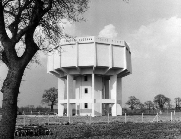 A 'modern' water tower between Great Ashfield and Elmswell, Suffolk, England. Date: 1950s