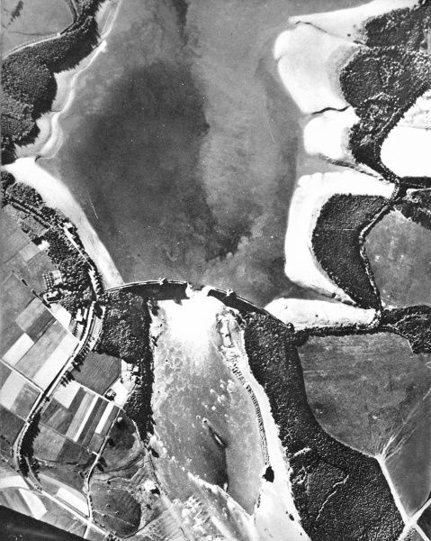 Aerial photograph showing the Mohne Dam and reservoir (top) after the 'Dambusters' raid of 1943. On the 16th May, 'Lancaster' bombers of 617 Squadron, led by Guy Gibson, attacked four dams in the Westphalia region of Germany