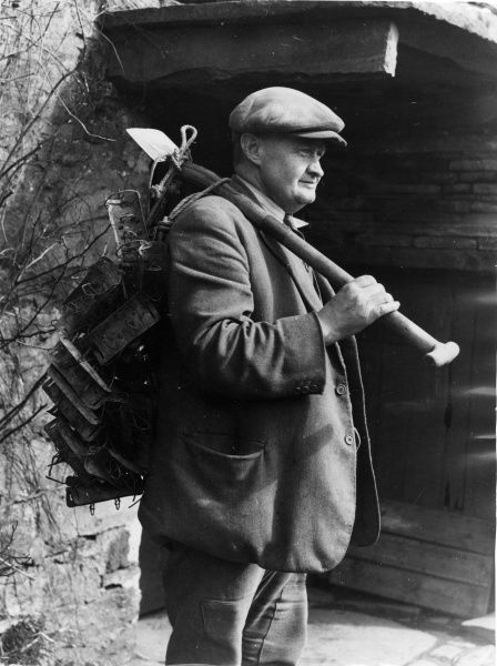 The mole catcher sets off, laden with his home-made traps, Burtersett, Wensleydale, Yorkshire, England