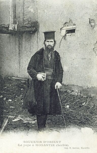 Monastir (formerly Bitola), Macedonia (formerly in Serbia and the Ottoman Empire) - The Head of the Serbian Orthodox Church, carrying a lightweight bag and bible. Date: circa 1910s
