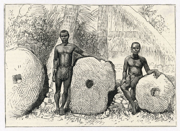 Two chiefs of Yap Island, western Caroline (Pacific) Islands with three huge perforated stones which were used as currency