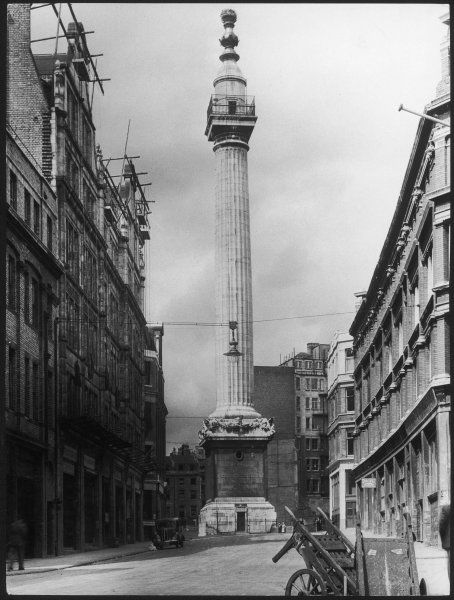 The Monument, Fish Street Hill, City of London, was designed by Sir Christopher Wren to commemorate the Great Fire of London in 1666. It was completed in 1677