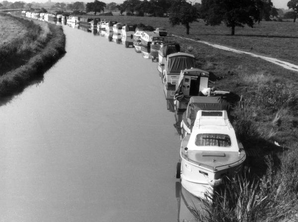 Moored craft on the Shropshire Union Canal, at Huntington, Cheshire, England. Date: 1960s