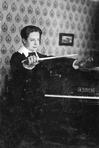 Moritz Lutzen, a musical boy prodigy -- he composed, conducted and played the piano. His later career seemed to focus mainly on the composition of popular songs. Seen here as a teenager, in conducting pose near a piano
