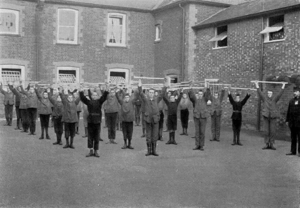 Morning drill at the East Harling, Norfolk, branch of the National Institutions for Persons Requiring Care and Control, an organisation privately run by the Rev Harold Burden to house 'feeble minded' children. The site, at Kenninghall