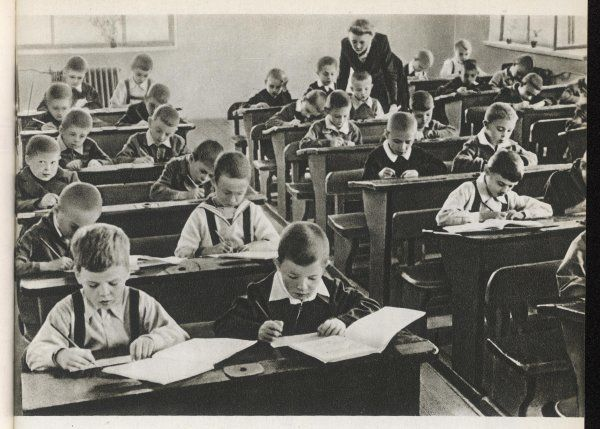 Beginning of the term at School no 170, Sverdlov district, Moscow. The teacher looks at the work of one of her boy pupils