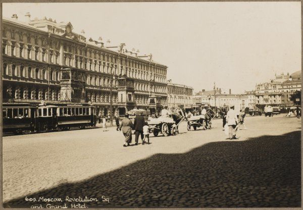 Moscow street scene shortly after the Revolution. Most of the traffic is horse-drawn. The Grand Hotel is on the left